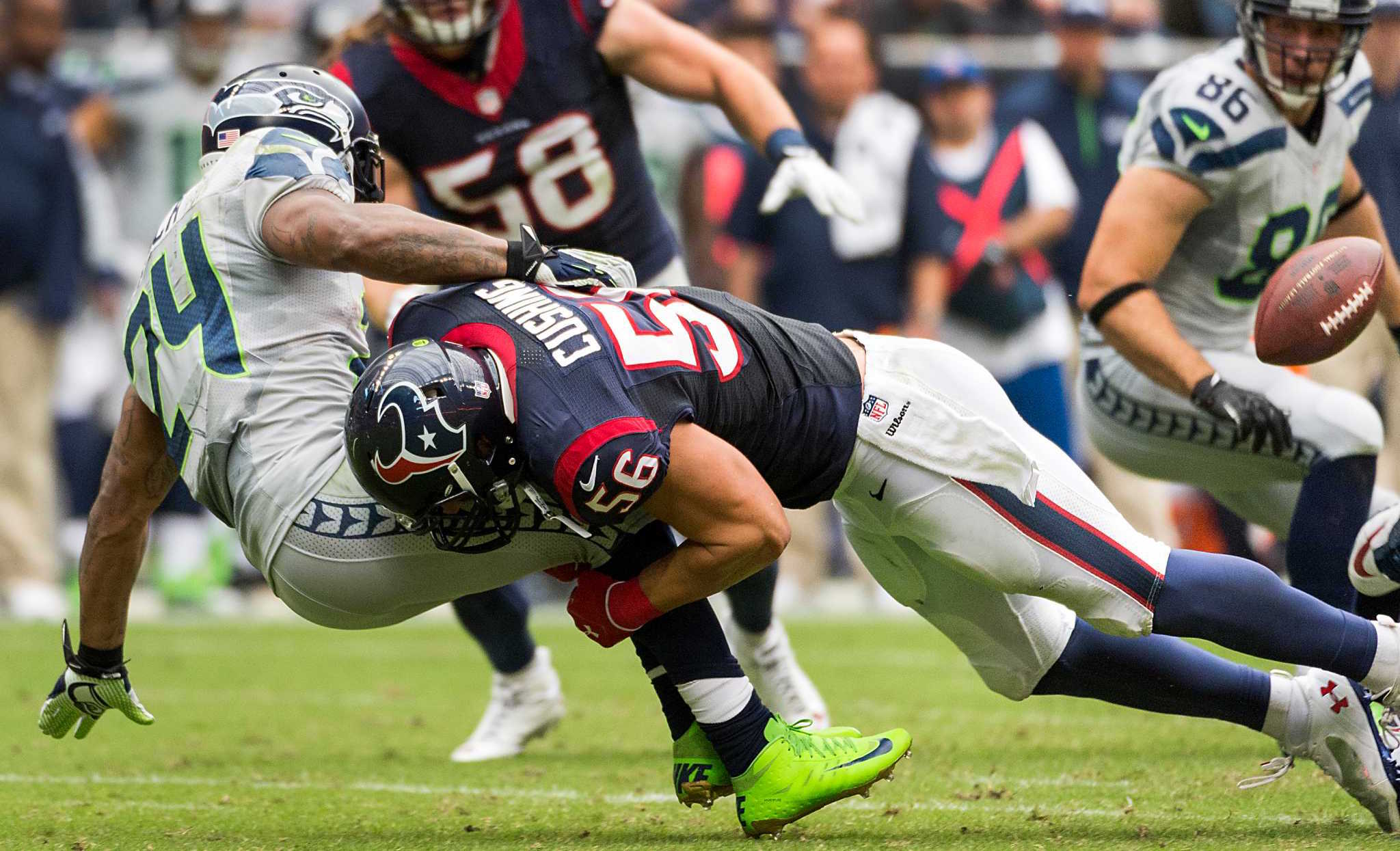 Seattle Seahawks running back Marshawn Lynch (24) fumbles as he is hit by Houston Texans inside linebacker Brian Cushing (56) during the first half of an NFL football game on Sunday, Sept. 29, 2013, in Houston. ( Smiley N. Pool / Houston Chronicle )