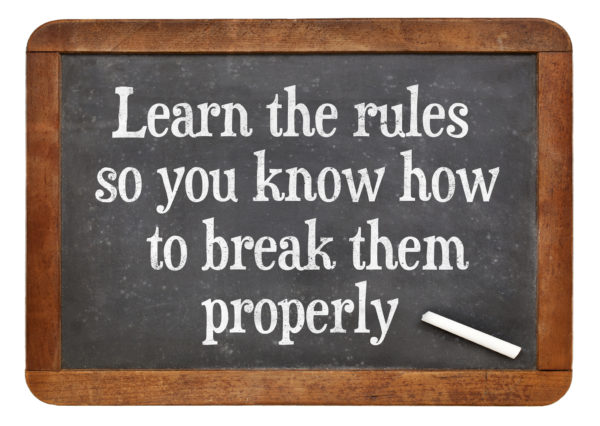 Learn the rules, so you know hot to break them properly. INspirational words on a vintage slate blackboard